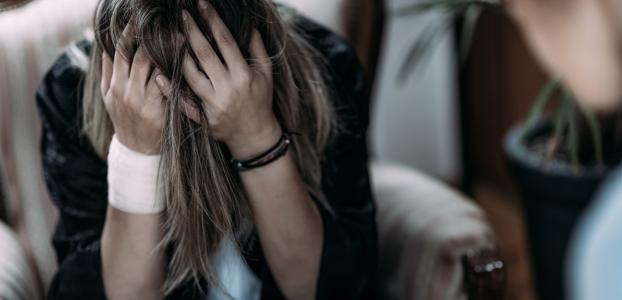 female-ptsd-patient-talking-with-psychotherapist-935PK69
